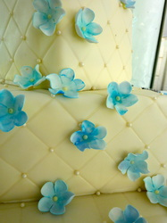 Lozenge effect fondant cake with blue hued sugar flowers. Raleigh, NC