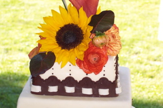 Summer flowers on a fresh chocolate embroidery border. Fondant wedding cake in Raleigh, NC