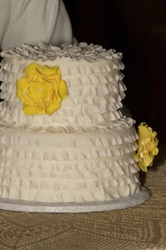 Fondant ruffles with a splash of yellow sugar flowers. Fondant cake in Durham, NC.