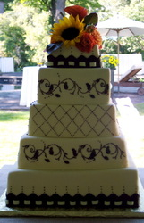Chocolate stitching and stencil on fondant wedding cake. Durham, NC
